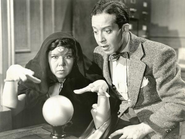 couple looks into a crystal ball