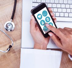 doctor using apps on smartphone