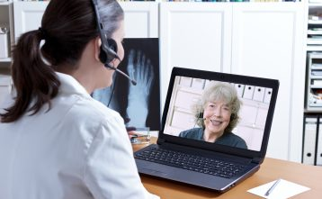 doctor cares for medicare patient via telehealth